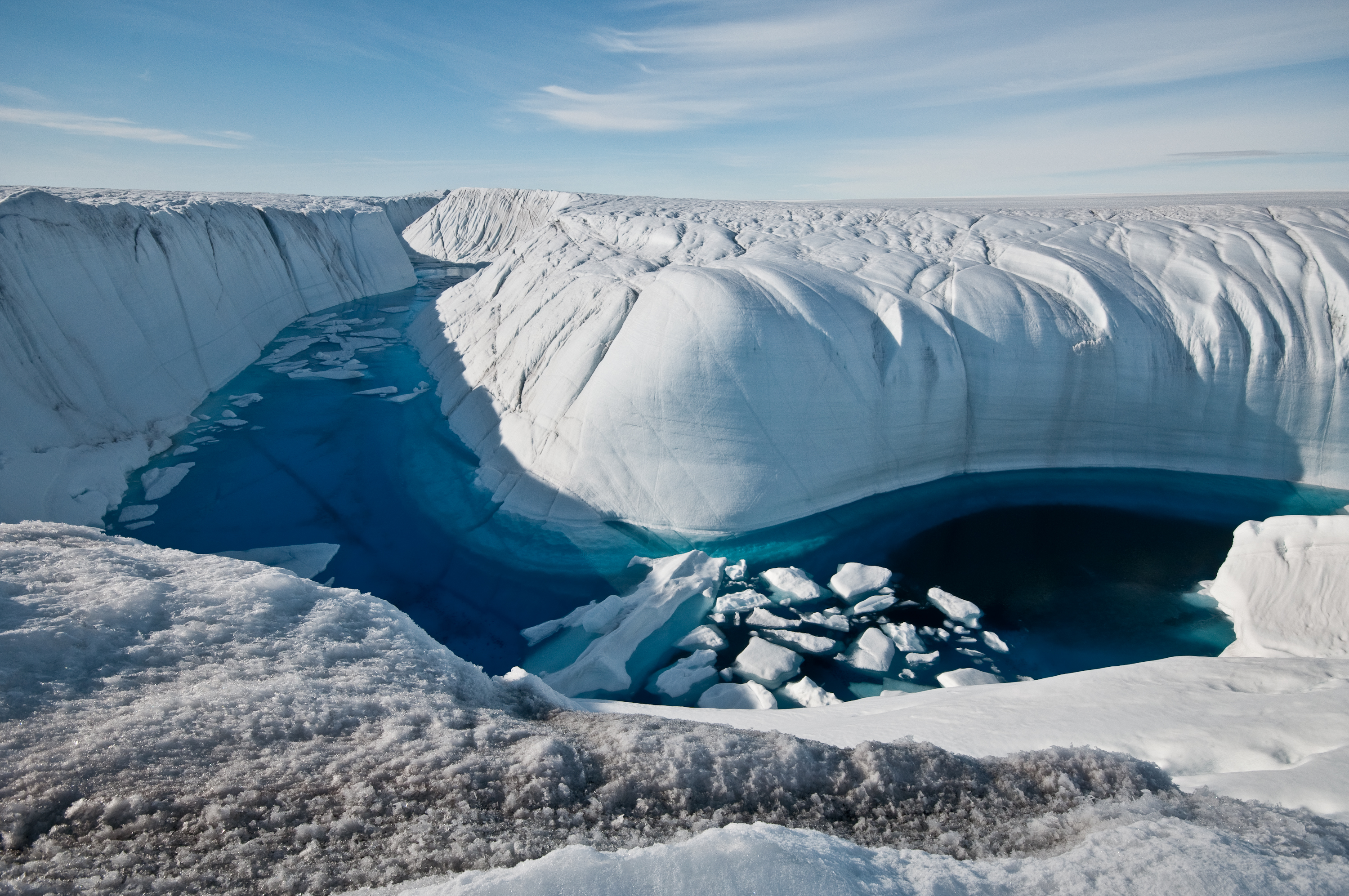 Greenland ice canyon filled with melt water in summer 2010 (photo: Ian Joughin, UW APL Polar Science Center)