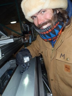 Markle examines an ice core in his lab.