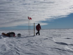 Taking ice core samples in Antarctica.