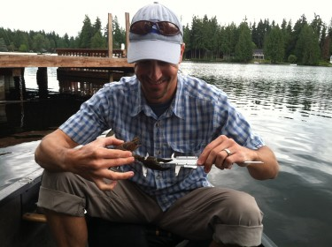School of Aquatic and Fishery Sciences' Julian Olden measuring an invasive crayfish on Pine Lake