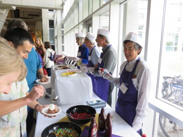 Members of the College's Executive Committee serve up ice cream sundaes at the College's Spring Celebration
