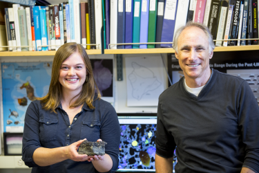 UW doctoral student Jillian Schleicher and UW professor of Earth and space sciences George Bergantz with a Mauna Loa basalt samples they will compare with the simulation results.