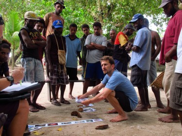 Joshua Cinner, at Australia's James Cook University, interviews fishermen in Papua New Guinea about adapting to changing social and environmental conditions