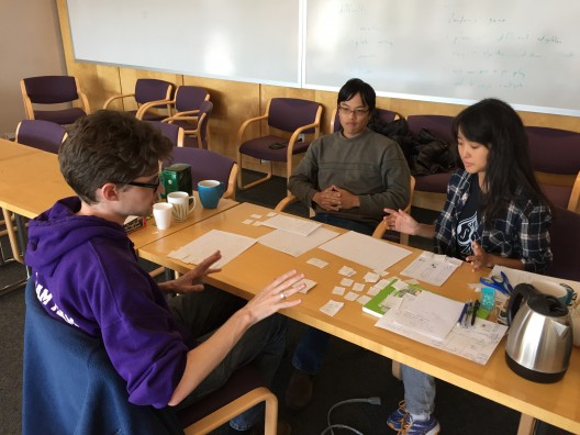 Rob Thompson, Will Chen, and Rachel Lee of EarthGamesUW working on their game AdaptNation at the Climate Game Jam.
