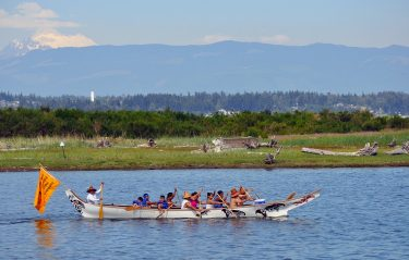 The Salmon Dancer Canoe Family paddles along the shorelines of Swinomish