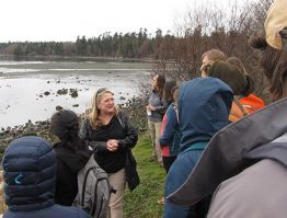 Friday Harbor Labs director Billie Swalla (center) spoke with class at San Juan Island's False Bay.