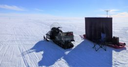 snow mobile on a field of white ice and snow