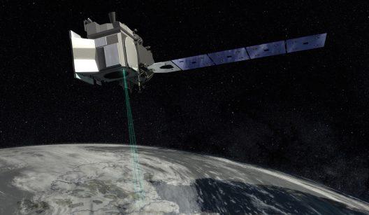 Satellite in dark sky hovering above Earth.