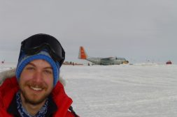 Nick in front of a plane on snow