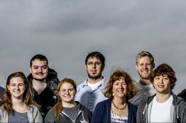 Faculty lead Lynn McMurdie, center, and some of the students from the winning UW team pose on the roof of the Atmospheric Sciences-Geophysics Building.