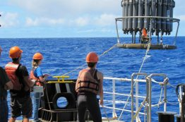 Students with an oceanography instrument