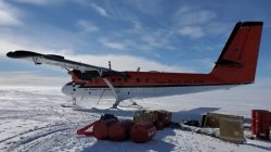 A Twin Otter plane on an Antarctic runway allows researchers like Holschuh to reach their study sites and collect radar data.