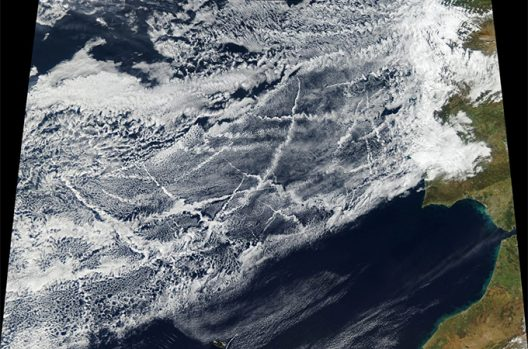 Pollution from ships create lines of clouds.