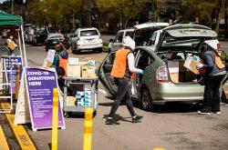 Volunteers unloading PPE at UW surplus
