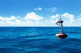 Guy on buoy in water