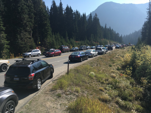 cars parked along a mountain highway